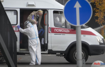 The latest: Russia sets a new daily record for virus deaths