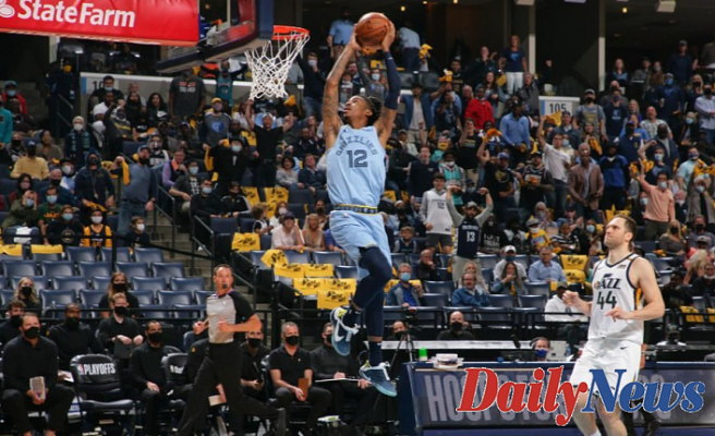 View Grizzlies' Ja Morant pull off 360 dunk in playoff game