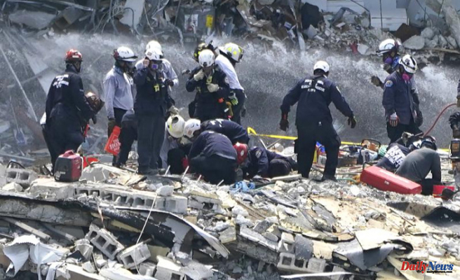 A fifth body is found in rubble