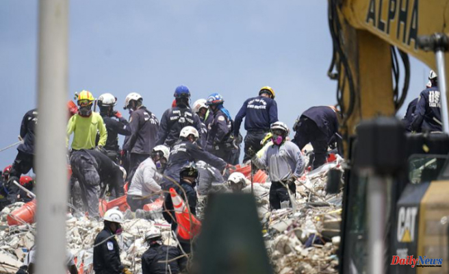 Crews spend fifth day on top of a shaky pile collapsed concrete
