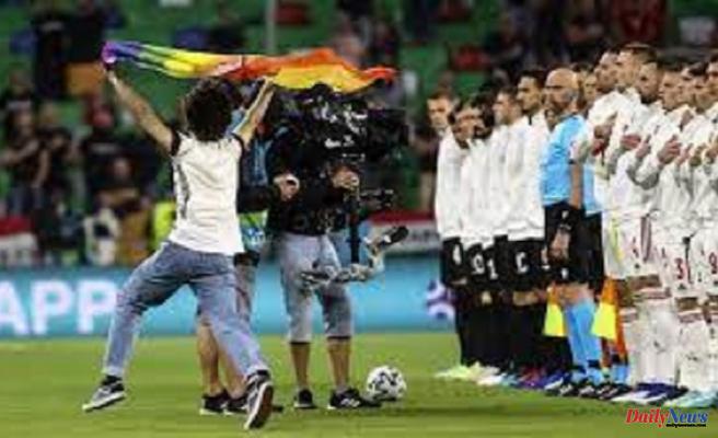 Pitch Invader Flys Pride Flag during Hungary's National Anthem
