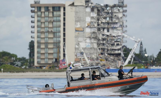 Rescue efforts at the condo-crash site are halted by safety concerns