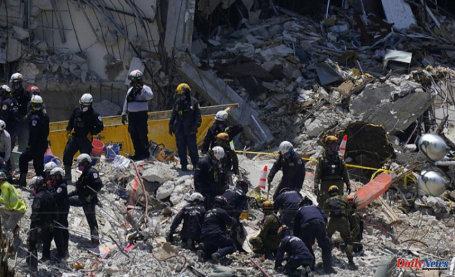 Two more bodies were found in the condo building that was destroyed
