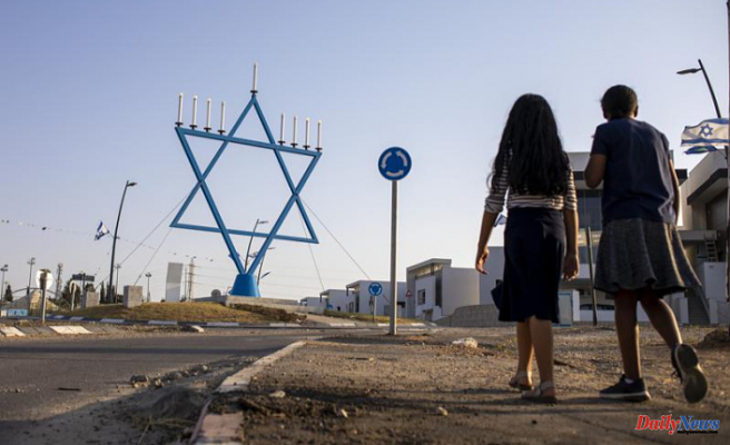 A calm Israeli town manages to withstand the rocket fire despite its size