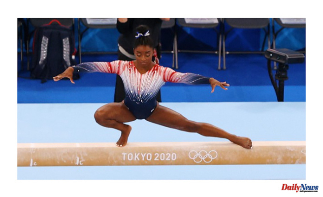 Simone Biles takes bronze in the balance beam finals, winning her seventh Olympic medal