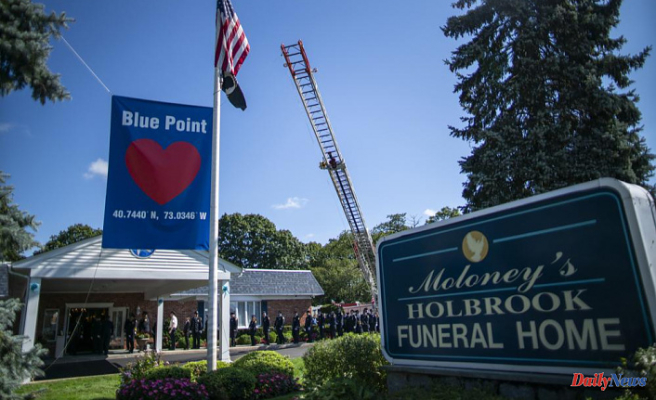 Gabby Petito's funeral home viewing is marked by a line of mourners