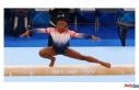 Simone Biles takes bronze in the balance beam finals,...