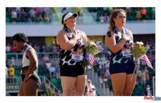 Gwen Berry moves away from the flag at US Olympic...