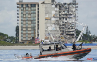 Rescue efforts at the condo-crash site are halted...
