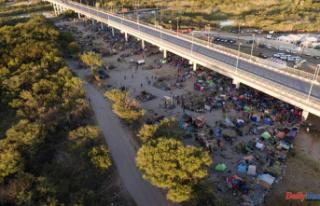 As removals increase, migrant camp at Texas border...