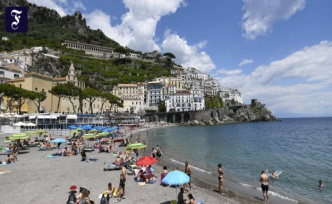 Pandemic summer in Italy: A day by the sea, with a mask
