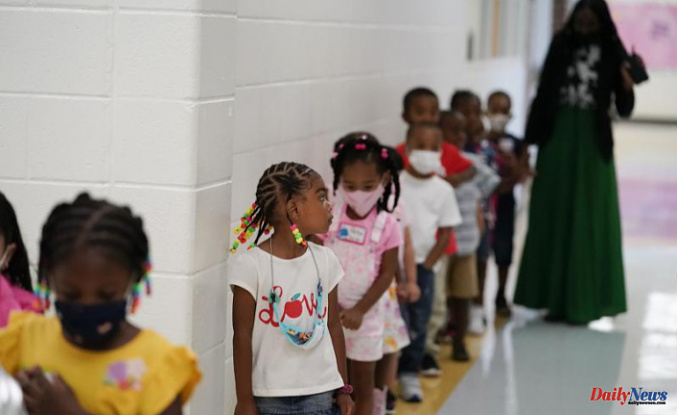 Many US schools reopen after masks are removed
