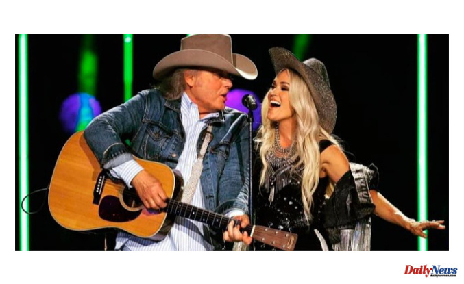 """Carrie Underwood and """"Legend Dwight Yoakam"""" perform an epic duet on stage at 'CMA Summer Jam"""